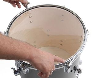 Putting on new drumheads